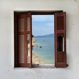 Beach landscape through broken window Royalty Free Stock Photo