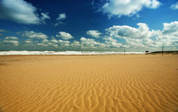 Beach landscape with clouds and sand. Beach landscape with many clouds and sand near the ocean royalty free stock photos
