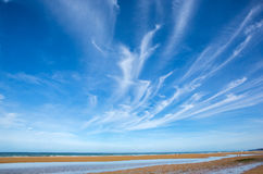 Beach and blue sky with clouds Royalty Free Stock Images