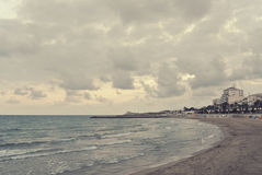Beach landscape on a cloudy windy afternoon; retro Instagram style Royalty Free Stock Image