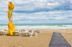 Beach landscape with colored umbrellas, nice sand and blue sky Stock Photography