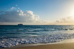 Beach landscape with cruise ship in the background. Beach and sea landscape with cruise ship in the background, taken in Kefalonia, Greece Stock Photos