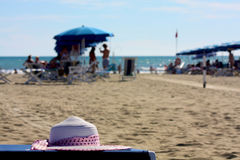 Beach landscape at Forte dei Marmi, Italy. Hat, seats and parasol at Forte dei Marmi, in a private beach Stock Images