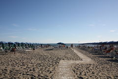 Beach landscape at Forte dei Marmi, Italy. Seats and umbrellas at Forte dei Marmi, in a private beach Stock Images
