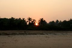 Beautiful sunrise in India on the ocean stock photo