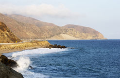 Beach landscape in Malibu. The ocean and waves during strong winds in United States, California. Waves breaking on the rocks Royalty Free Stock Photography