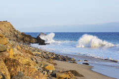 Beach landscape in Malibu. The ocean and waves during strong winds in United States, California. Waves breaking on the rocks Stock Image