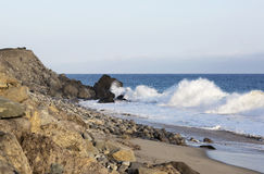 Beach landscape in Malibu. The ocean and waves during strong winds in United States, California. Waves breaking on the rocks Royalty Free Stock Photos