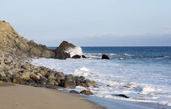 Beach landscape in Malibu. The ocean and waves during strong winds in United States, California. Waves breaking on the rocks Royalty Free Stock Images