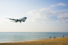The beach landscape, the plane comes in the land Stock Photography
