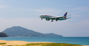 The beach landscape, the plane comes in the land Stock Photo
