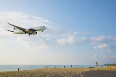The beach landscape, the plane comes in the land Stock Photos