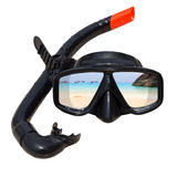 The beach landscape is reflected in diving mask and snorkel on the beach.  Royalty Free Stock Photos
