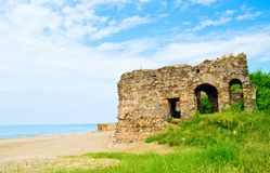 Beach landscape with ruins of castle. Beautiful tropical beach landscape with ruins of castle Stock Photography