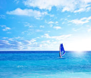 Beach landscape with windsurfer playing Royalty Free Stock Photography