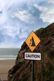 Beach landslide caution sign Stock Photos