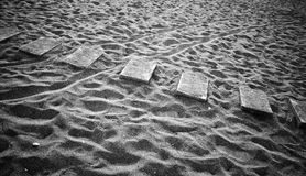 Beach lane. Abstract composition: beach lane made of seven flat concrete blocks in the sand Stock Images