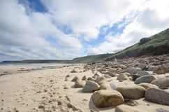 Beach with large rocks and sand Royalty Free Stock Photography