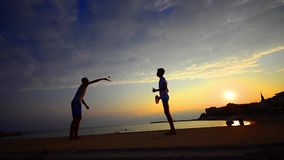 Beach leisure tennis game. stock video footage
