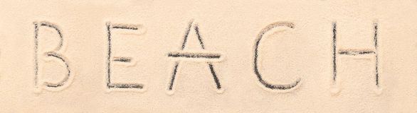 Beach lettering drawn on sand. Summer beach background stock images
