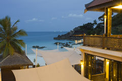 Beach life at evening. White awnings beside cafe on the beach, Redang Island, Malaysia Stock Image