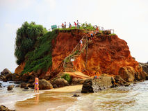 Beach life at Mirissa Sri Lanka featuring vacationers enjoying themselves in the water. Royalty Free Stock Photo