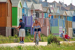 Beach life. Photo of a senior cyclist at whitstable seaside in kent Royalty Free Stock Photo