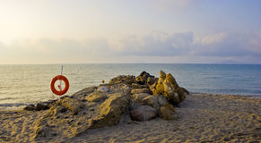 Beach and life preserver. Ocean and beach with life preserver on Kos island in Greece Stock Photography