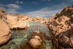 Beach life at Spiaggia Cala Coticcio. On the Italian island of Caprera royalty free stock image