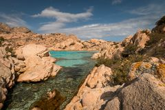 Beach life at Spiaggia Cala Coticcio. On the Italian island of Caprera stock image