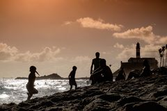Beach life on an urban beach in Salvador de Bahia, Brazil just b stock photos