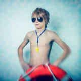 Beach lifeguard boy Royalty Free Stock Image