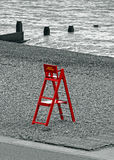 Beach lifeguard chair. Photo of a colour-popped red beach lifeguard chair on kent coast of whitstable royalty free stock image
