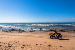 Beach Lifeguard MotorCycle Quad. Lifeguard along the beach on a quad motorbike at Umhlanga Rocks Stock Images
