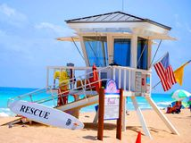 Beach Lifeguard Rescue Station. The lifeguard rescue station allows vacationers to enjoy themselves safely on the beach stock photography