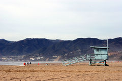 Beach lifeguard stand. Lifeguard tower or stand on the beach at Santa Monica, California on a cloudy day Stock Photos