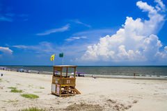 On the Beach with Lifeguard Station and big Cloud. Stock Photos