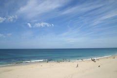 Beach lifestyle. Beautiful sandy beach with a few tourists.  Australia Royalty Free Stock Photography