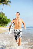 Beach lifestyle people - man surfer with surfboard Stock Photos