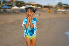 Free Beach Lifestyle Portrait Of Young Beautiful And Happy Asian Child Girl 8 Or 9 Years Old With Cute Double Buns Hair Style Playing Stock Photos - 153047253