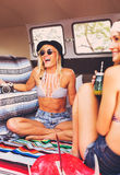Beach Lifestyle Surfer Girls in Vintage Surf Van Stock Photography