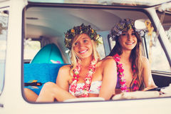 Beach Lifestyle Surfer Girls in Vintage Surf Van stock image