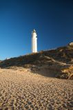 Beach and lighthouse Royalty Free Stock Photos