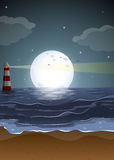 A beach with a lighthouse and a fullmoon Royalty Free Stock Images