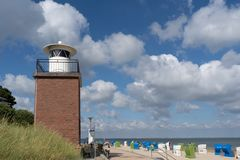 Beach and lighthouse on the German North Sea island. Fohr stock image