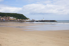 Beach and lighthouse at Scarborough. North Yorkshire, United Kingdom for family holidays and vacations Royalty Free Stock Photos