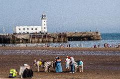 Beach and lighthouse in summer Stock Images