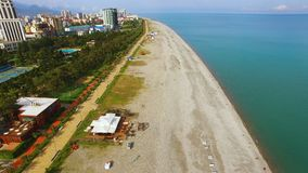 Beach line in Batumi Georgia, popular tourist destination, summertime holidays. Stock footage stock video