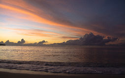 Beach line during sunrise. Beach line during sunrise with colorful clouds Royalty Free Stock Images