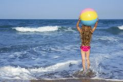 Beach little girl colorful ball Stock Images